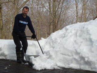 Got Snow? Ken shoveling the roof near the snowman. How's the snow in your area? 2-7-09.