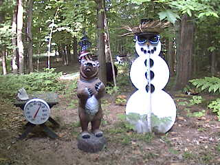 There is a real bear in this picture. Can you see it? Back by the tree between the snowman and the fake bear. June 2nd, 2007