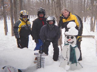 Bettelon family standing next to the snowman cam.