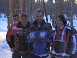 Ken Borton, with Adam and Kim Kuliczkowski, showing off the Snowman Cam cookies made by Kim. Thanks Kim, they are delicious! 1-16-10