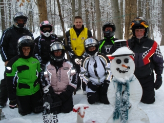 Some of the many participants from the Third Annual Pink Ribbon Riders snowmobile ride, in Gaylord, to promote breast cancer awarness. 2-15-08
