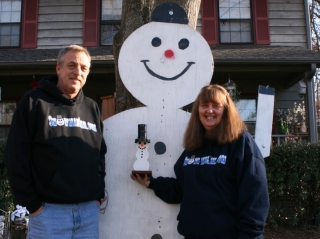 Tree and Michael Merwin with little snowman and 27 year old big snowman named Frosty, in Taylors South Carolina. January 2, 2008
