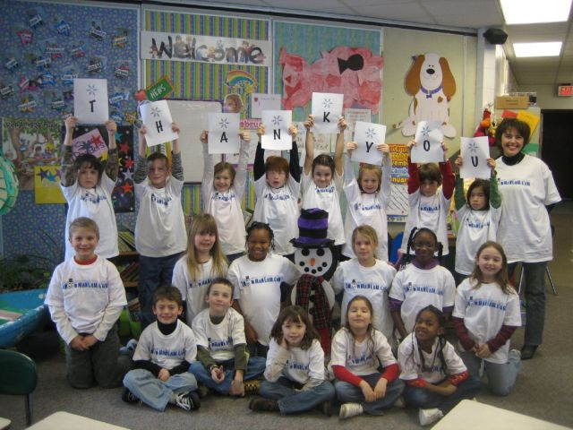 Ms. Guccini's class receives Snowman Cam T-Shirts.